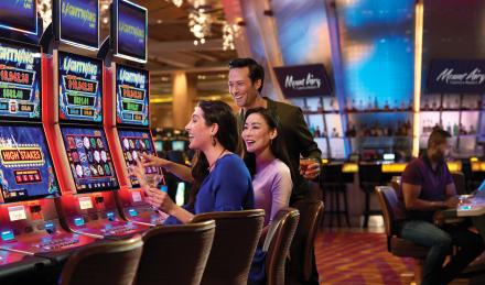 Group playing slot machines at Mount Airy Casino Resort. Mount Pocono. Pennsylvania.