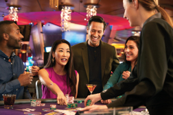 Group playing card games in casino at Mount Airy Casino Resort. Mount Pocono, Pennsylvania.